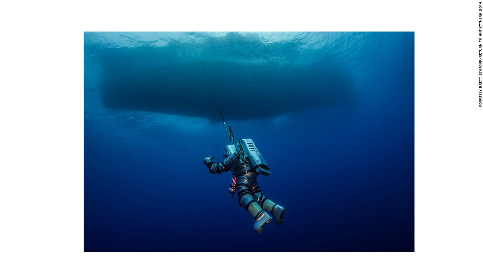 """WHOI diving safety officer Edward O'Brien """"spacewalks"""" in the next-gen atmospheric """"Exosuit,"""" during the 2014 Return to Antikythera project, which ran from September 15 to October 7. The divers are planning to return to the Antikythera next year to continue excavating the site following a successful first season."""