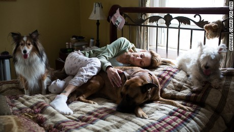 Christine Koch lies in bed in the morning with her and her son Billy's dogs in Milltown, New Jersey, on November 17, 2013.