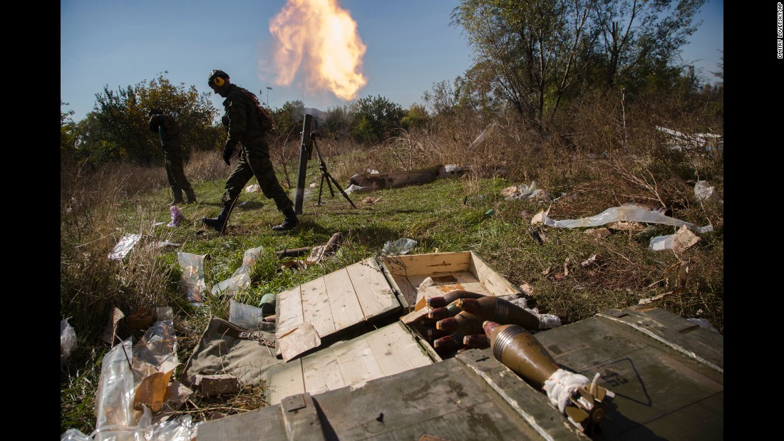 Pro-Russian rebels fire mortars toward Ukrainian positions near to the Donetsk airport on October 8.