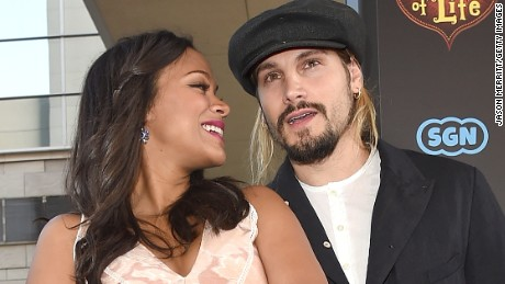 Zoe Saldana and husband Marco Perego share an affectionate moment on the red carpet of Saldana#39;s new movie, quot;The Book of Life.quot;