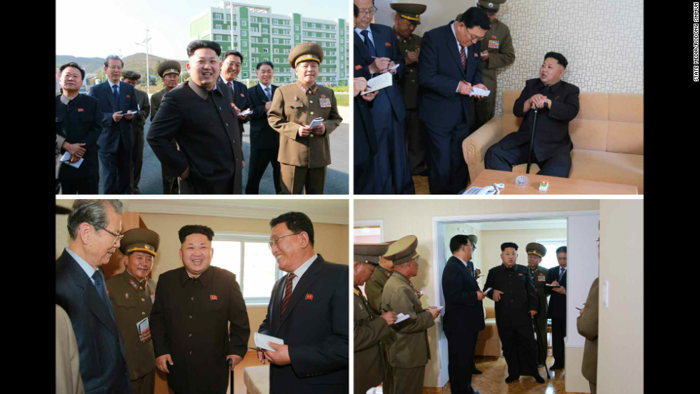 "The North Korean leader gave ""field guidance"" to a newly built residential district, state news agency KCNA reported. Here, Kim appears with officials while walking with a cane."