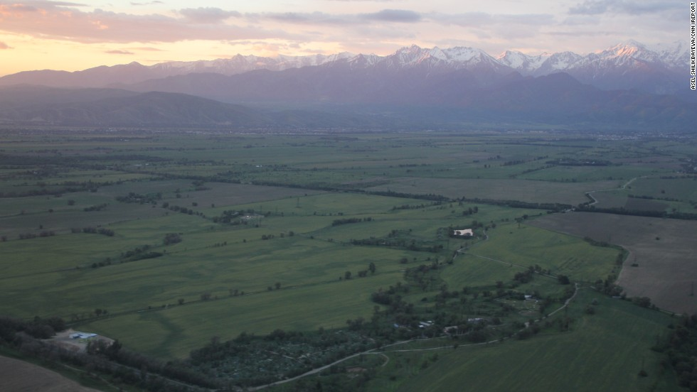 "The Tian-Shan, Central Asia's longest system of mountain ranges, is set aglow by the pastel sky draping over <a href=""http://ireport.cnn.com/docs/DOC-817792"">Almaty, Kazakhstan</a>."