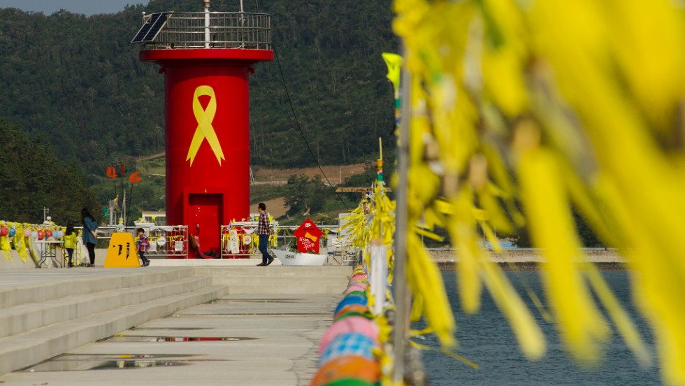 Jindo harbor, where the search operation is based, has become a memorial for those who lost their lives. Yellow ribbons and photos are displayed as people come to pay their respects.