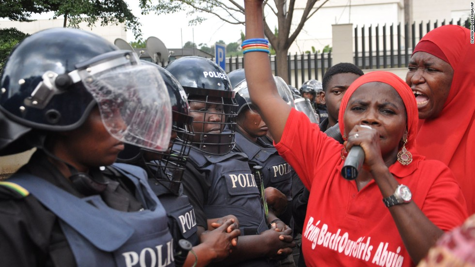 Police in riot gear block a route in Abuja, Nigeria, on Tuesday, October 14, during a demonstration calling on the Nigerian government to rescue schoolgirls kidnapped by the Islamist militant group Boko Haram. In April, more than 200 girls were abducted from their boarding school in northeastern Nigeria, officials and witnesses said.