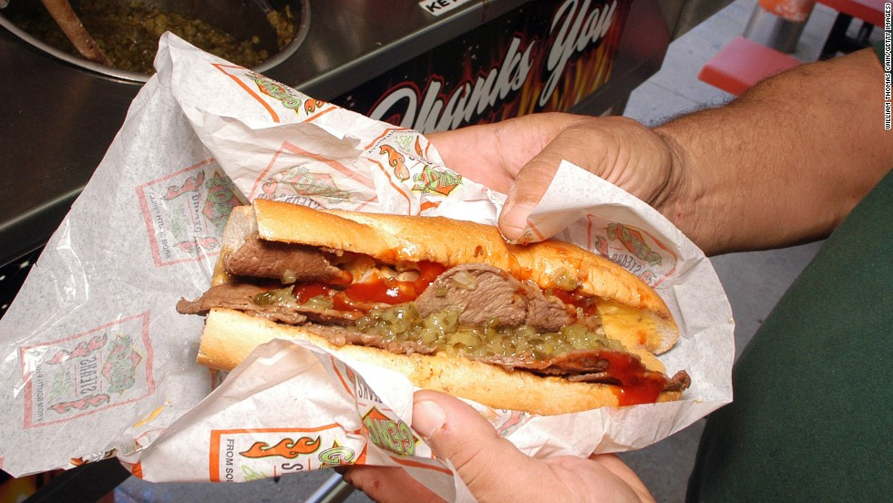 The cheesesteak (this one from Geno's Steaks) is a Philadelphia staple. Another is scrapple: pig trimmings in cornmeal and flour formed into a loaf. Slice and pan-fry until all you can taste is heart surgery.