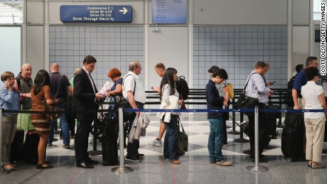 CHICAGO, IL - SEPTEMBER 24: Passengers wait in line to go through security screening at O'Hare International Airport's Terminal 1 shortly after the terminal was reopened on September 24, 2014 in Chicago, Illinois. The ticketing and baggage claim areas of the terminal were evacuated for nearly two hours after a after an unattended bag was discovered around 9:30 this morning. (Photo by Scott Olson/Getty Images)
