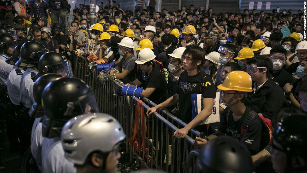 Police and protesters face each other across a barricade as tensions continue in Hong Kong on Monday, October 20.