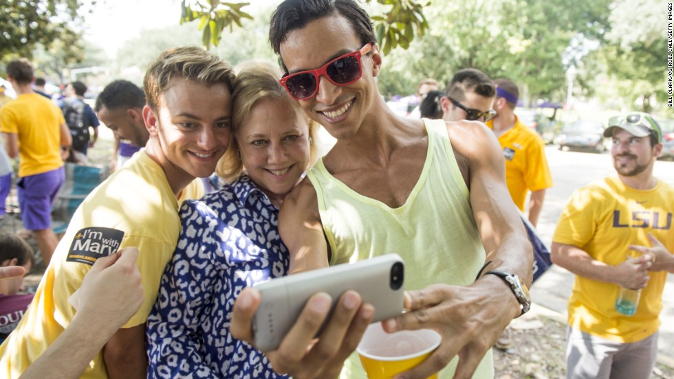Landrieu poses for a selfie in September with football fans tailgating at Louisiana State University in Baton Rouge.