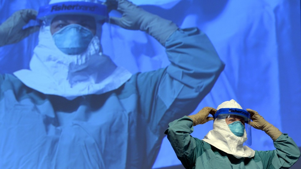 "A nurse at Mount Sinai Health Systems in New York demonstrates the proper technique for donning and removing protective gear. The Centers for Disease Control and Prevention updated its protective gear and <a href=""http://www.cdc.gov/vhf/ebola/healthcare-us/ppe/guidance.html"" target=""_blank"">disease-management protocols</a>. It also <a href=""http://www.cdc.gov/vhf/ebola/exposure/qas-monitoring-and-movement-guidance.html"" target=""_blank"">sent out guidance </a>to help frightened Americans better understand that the virus was unlikely to get them in their homes."