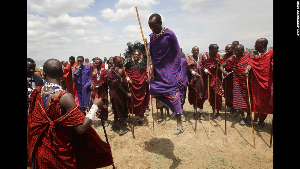 Maasai men prepare to greet Camilla, Duchess of Cornwall, and Prince Charles as they visit Majengo Maasai Boma in 2011 in Arusha, Tanzania. The lifestyle of the Maasai, one of the last warrior tribes in the world, revolves around cattle herding.