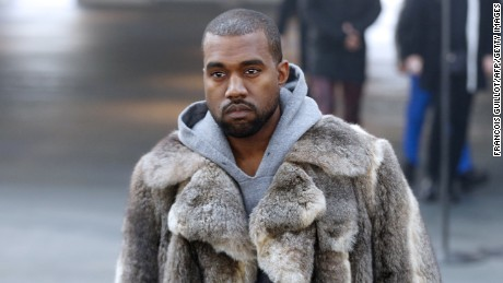 US musician Kanye West arrives to attend Givenchy's Fall/Winter 2014-2015 men's fashion show in Paris on January 17, 2014.   AFP PHOTO FRANCOIS GUILLOT        (Photo credit should read FRANCOIS GUILLOT/AFP/Getty Images)