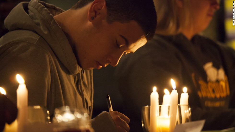 "Students from Marysville-Pilchuck High School write messages and prayers during a vigil Friday, October 24, at a church in Marysville, Washington. Earlier in the day, <a href=""http://www.cnn.com/2014/10/27/us/washington-school-shooting/index.html"">a student shot five people at the school</a> before he committed suicide, law enforcement officials told CNN."
