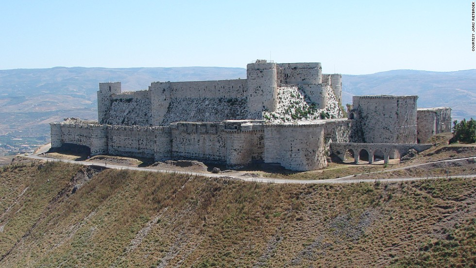 "The Crusader castle from the 11th century survived centuries of battles and natural disasters, becoming a World Heritage site in 2006 along with the adjacent castle of Qal'at Salah El-Din. The walls were severely damaged by <a href=""http://ghn.globalheritagefund.com/uploads/documents/document_2107.pdf"" target=""_blank"">regime airstrikes and artillery in 2013</a>, and rebels took positions within it."