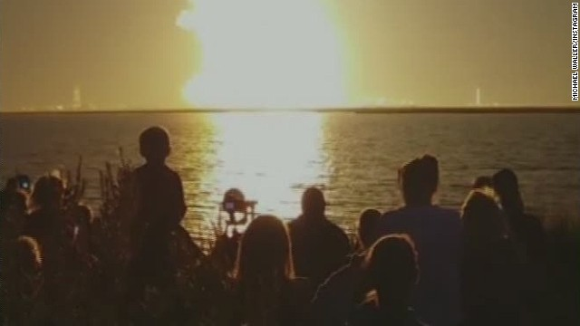 Video shows crowd watching rocket explode
