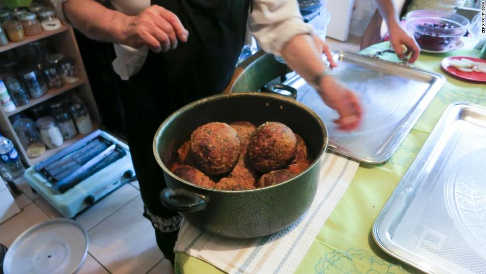 An Iranian family prepares a pot of stuffed kofta, or meatballs, for Bourdain.