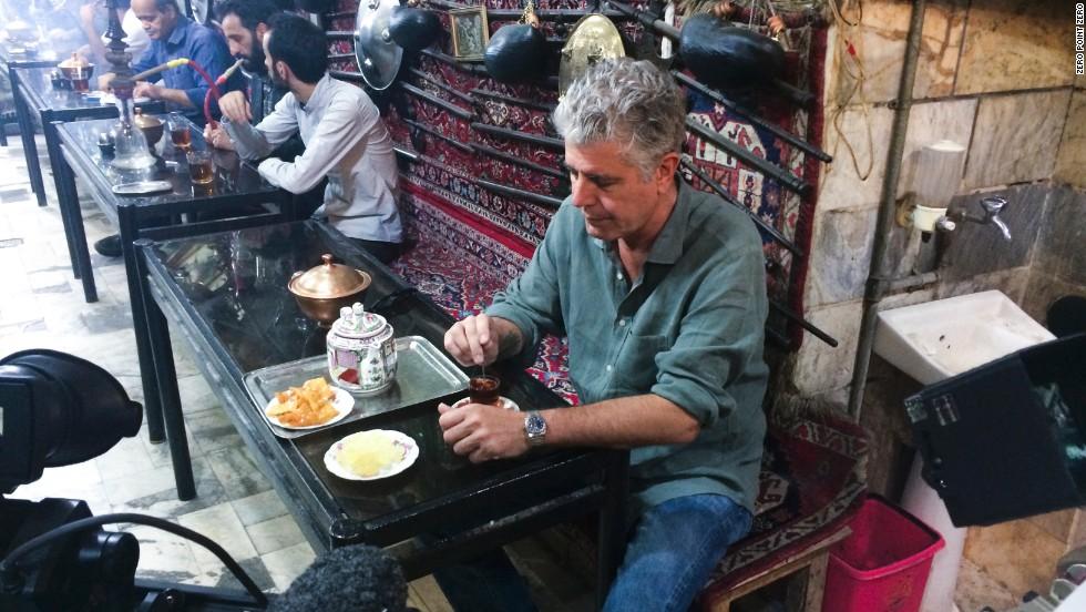 Bourdain stops for tea in a bazaar in Iran.