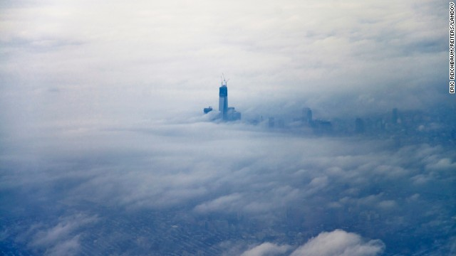 Image #: 21466059    The new World Trade Center building pokes its head above the clouds over New York December 2, 2012 in this aerial photo taken by photographer Eric Reichbaum from an airplane leaving Laguardia Airport.   REUTERS/Eric Reichbaum (UNITED STATES - Tags: CITYSCAPE TRAVEL SOCIETY)       REUTER /ERIC REICHBAUM/Reiters/LANDOV