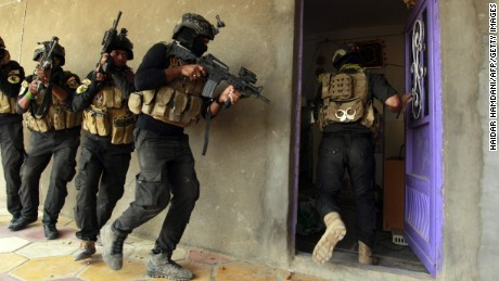 Iraqi special forces search a house in the Jurf al-Sakhr area, north of the Shiite shrine city of Karbala on October 30, 2014, after they retook the area from Islamic State (IS) group jihadists over the weekend after months of fighting the regain the ground. AFP PHOTO/HAIDAR HAMDANI        (Photo credit should read HAIDAR HAMDANI/AFP/Getty Images)