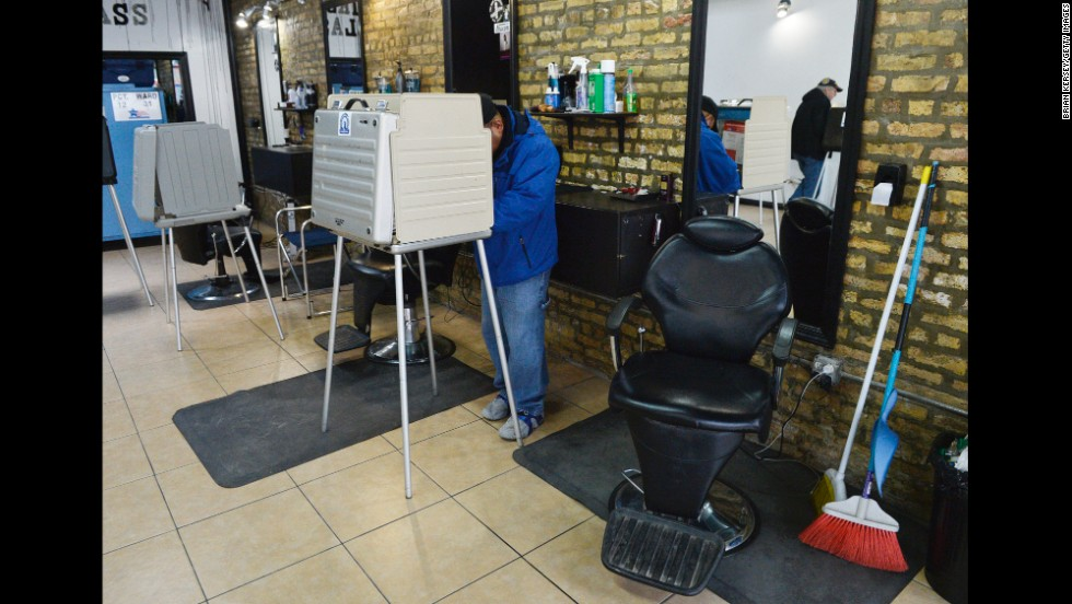 Voters cast their ballots at First Class Barber Shop in Chicago.
