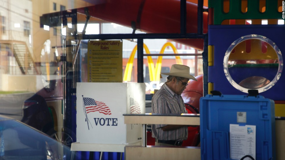 People in Los Angeles vote at a polling place set up in the playground of a McDonald's.