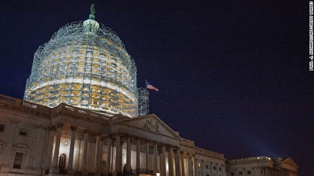 The US Capitol dome is cocooned in scaffolding on October 28, 2014 in Washington, DC as it undergoes  its first comprehensive repairs in more than half a century a century. The two-year, USD 60 million project is aimed at repairing nearly 1,300 cracks that have emerged in the nine-million-pound (4.1-million-kilogram) cast iron dome, according to the Architect of the Capitol (AOC) office.  Construction on the dome began in 1855. Work symbolically continued through the US Civil War and the structure was eventually completed in 1866.    AFP Photo/Paul J. Richards        (Photo credit should read )