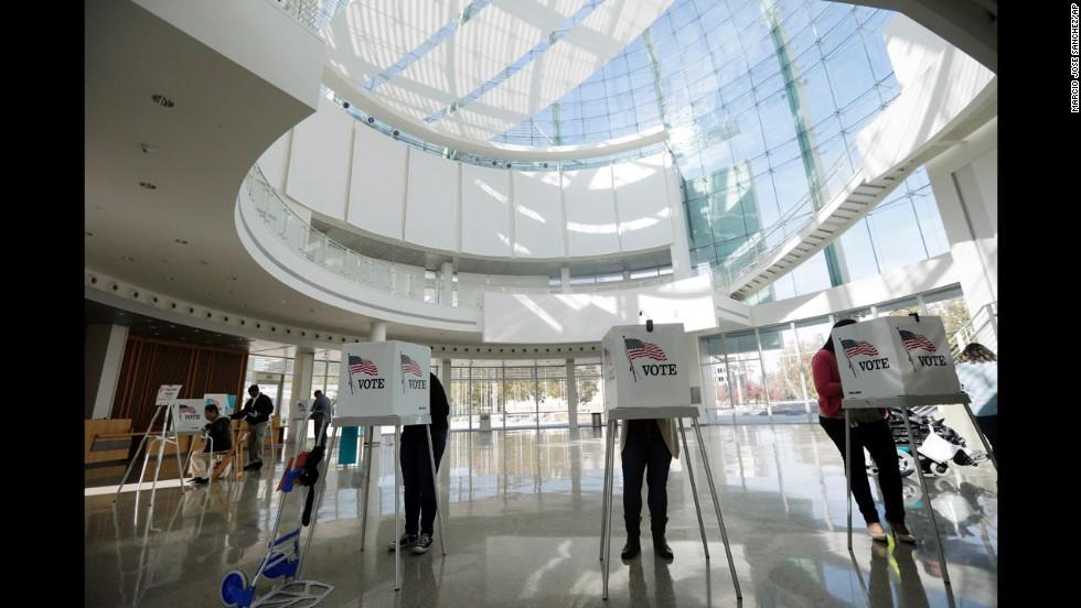 People vote inside the City Hall rotunda in San Jose, California.