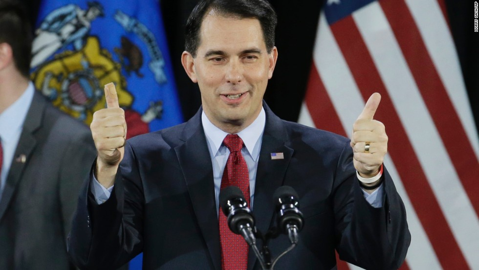 Wisconsin Republican Gov. Scott Walker gives a thumbs-up as he speaks at his campaign party in West Allis, Wisconsin, on Tuesday, November 4. Walker defeated Democratic gubernatorial challenger Mary Burke.