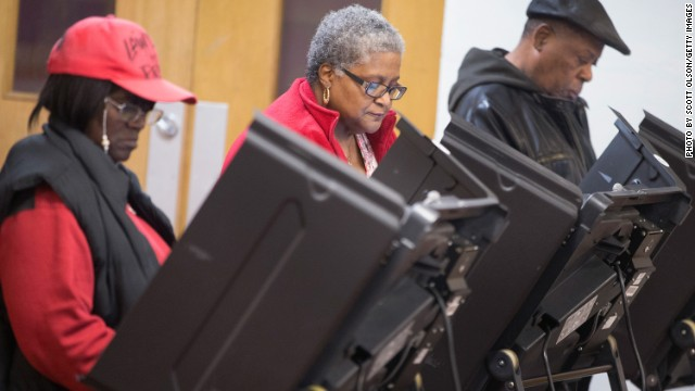 FERGUSON, MO - NOVEMBER 04: Residents cast their votes at a polling place on November 4, 2014 in Ferguson, Missouri. In last Aprils election only 1,484 of Ferguson's 12,096 registered voters cast ballots. Community leaders are hoping for a much higher turnout for this election. Following riots sparked by the August 9 shooting death of Michael Brown by Darren Wilson, a Ferguson police officer, residents of this majority black community on the outskirts of St. Louis have been forced to re-examine race relations in the region and take a more active role in the region's politics. Two-thirds of Fergusons population is African American yet five of its six city council members are white, as is its mayor, six of seven school board members and 50 of its 53 police officers. (Photo by Scott Olson/Getty Images)