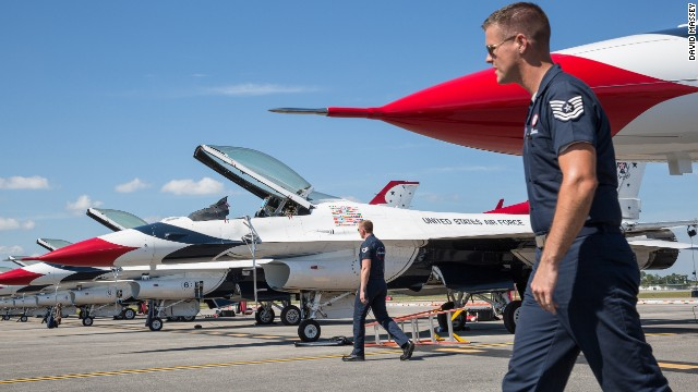 F-16 airplanes sit before the Embry-Riddle Aeronautical University's Wings and Waves Air Show.