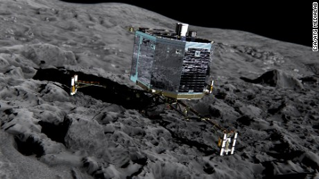 Artist#39;s impression of Rosetta#39;s lander Philae (front view) on the surface of comet 67P/Churyumov-Gerasimenko. Philae will be deployed to the comet in November 2014 where it will make in situ observations of the comet surface, including drilling 23cm into the subsurface to extract material for analysis in its on board laboratory.