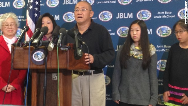 Kenneth Bae stands with his sister Terri Chung and his mother Myunghee Bae and his nieces at Joint Base Lewis-McChord  after his flight just landed in the United States.