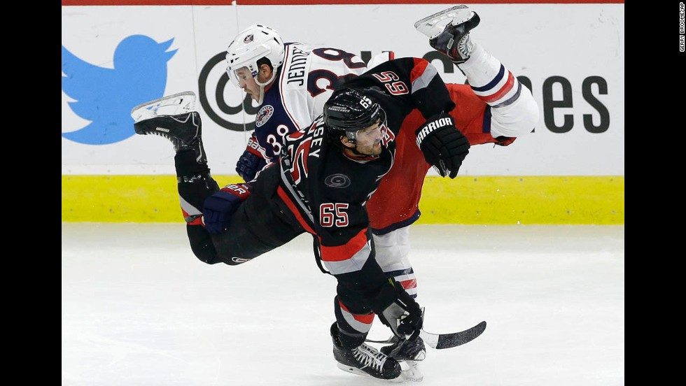 Ron Hainsey of the Carolina Hurricanes and Boone Jenner of the Columbus Blue Jackets collide during their game in Raleigh, North Carolina, on Friday, November 7. Carolina won 3-2 in overtime.