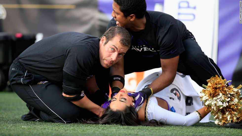A Baltimore Ravens cheerleader is tended to after falling during a game against the Tennessee Titans at M&T Bank Stadium in Baltimore, Maryland, on Sunday, November 9.