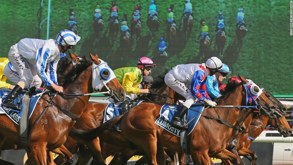 Horses race out of the gates during the 2014 Crown Oaks at Flemington Racecourse in Melbourne, Australia, on Thursday, November 6. The race was won by Hugh Bowman riding Set Square.