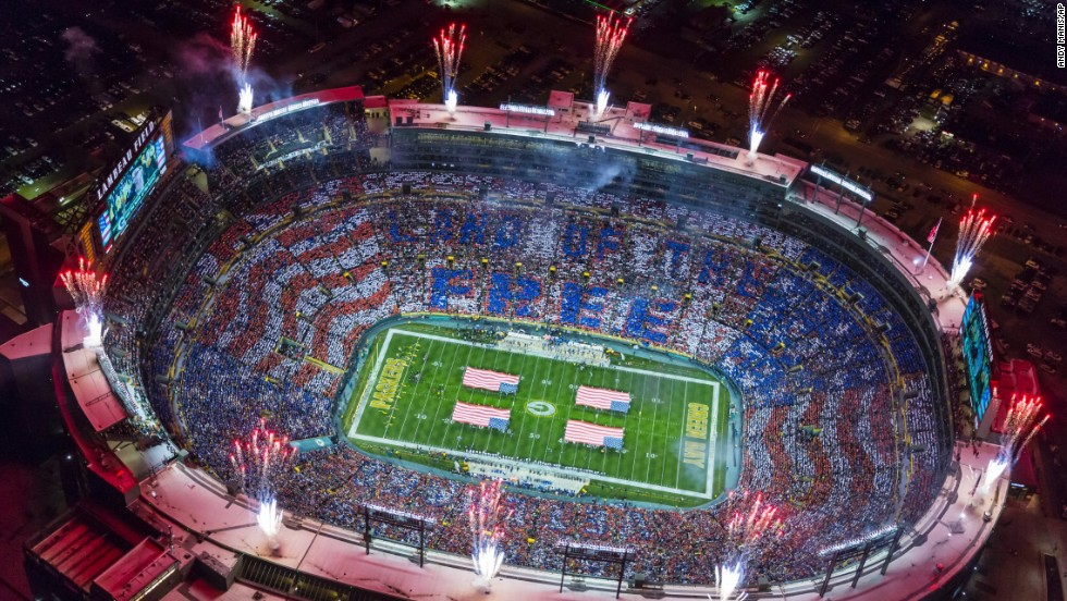 Fans participate in a USAA Salute to Service stunt during the national anthem prior to the start of the NFL game between the Green Bay Packers and Chicago Bears on Sunday, November 9, at Lambeau Field in Green Bay, Wisconsin. The Packers won 55-14.