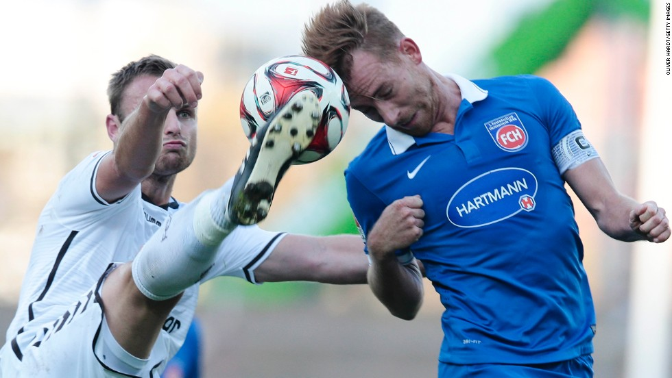 Bernd Nehrig of FC St. Pauli, left, and Marc Schnatterer of 1. FC Heidenheim compete for the ball during the Second Bundesliga match on Saturday, November 8, at Millerntor Stadium in Hamburg, Germany.