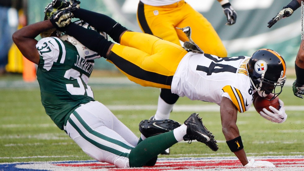 New York Jets free safety Jaiquawn Jarrett tackles Pittsburgh Steelers' Antonio Brown in the first half on Sunday, November 9, at MetLife Stadium in East Rutherford, New Jersey.
