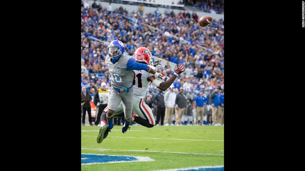 Kentucky cornerback Cody Quinn, left, breaks up a pass intended for Georgia wide receiver Chris Conley at Commonwealth Stadium in Lexington, Kentucky, on Saturday, November 8. The Georgia Bulldogs beat the Kentucky Wildcats 63-31.