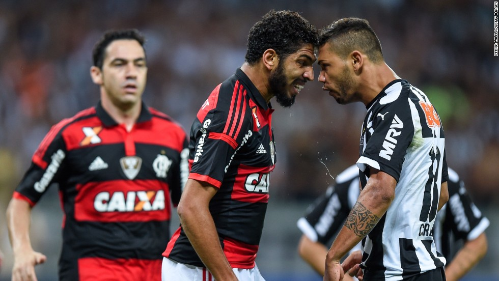Carlos of Atletico MG and Wallace of Flamengo battle for the ball during a 2014 Copa do Brasil match at Mineirao Stadium in Belo Horizonte, Brazil, on Wednesday, November 5.