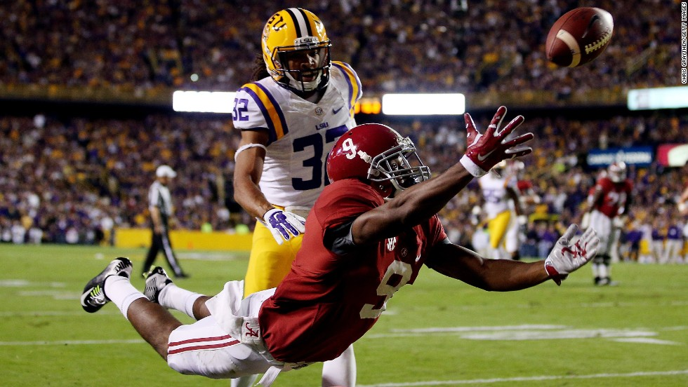 Amari Cooper of the Alabama Crimson Tide fails to make a catch in the second quarter as Jalen Collins of the LSU Tigers defends on Saturday, November 8, at Tiger Stadium in Baton Rouge, Louisiana. Alabama defeated LSU 20-13.
