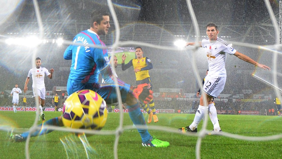 Alexis Sanchez of Arsenal scores past Lukasz Fabianski of Swansea during a match in the Barclays Premier League at Liberty Stadium in Swansea, Wales, on Sunday, November 9. Swansea won 2-1.