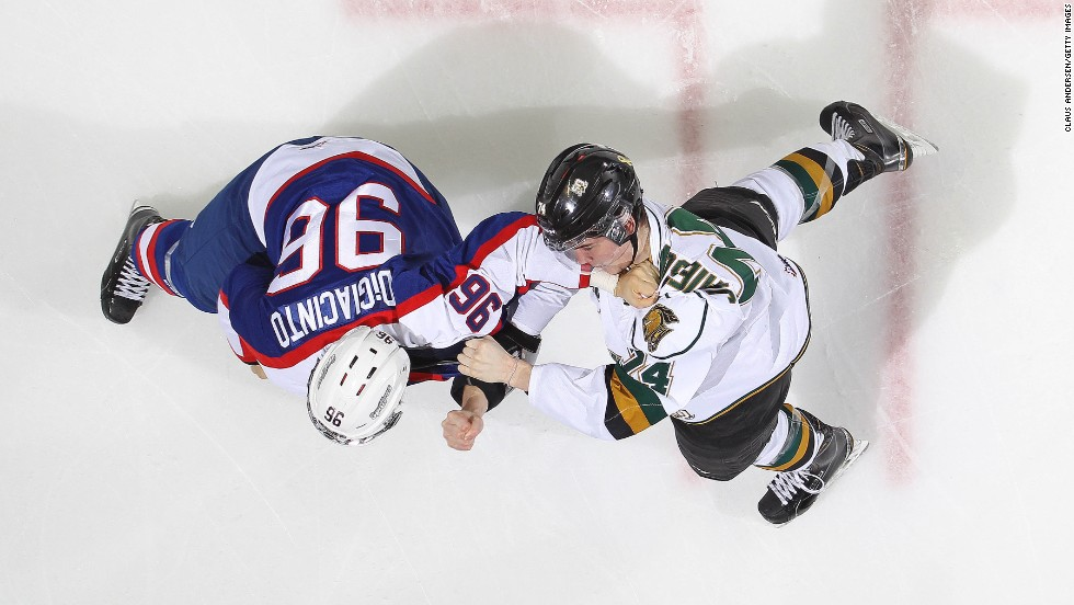 Christiano DiGiacinto of the Windsor Spitfires dukes it out with Aiden Jamieson of the London Knights in an Ontario Hockey League game at Budweiser Gardens in London, Ontario, on Friday, November 7. The Knights defeated the Spitfires 5-3.