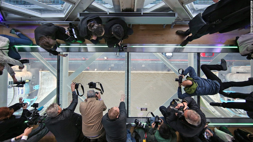 Photographers in London get a unique view of the River Thames from Tower Bridge's glass walkway in November 2014.