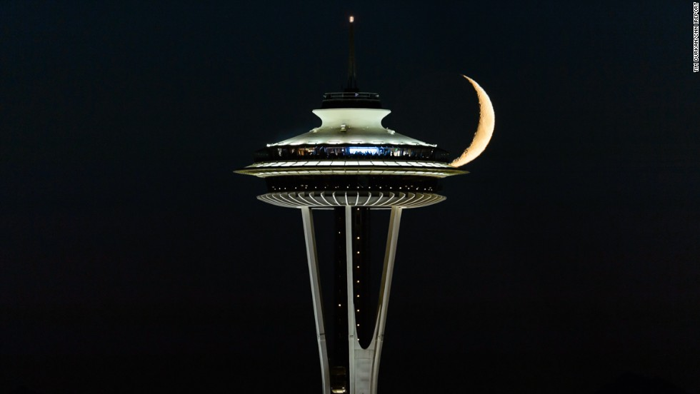 "It took photographer <a href=""http://ireport.cnn.com/docs/DOC-1157291"">Tim Durkan</a> ""a lot of prep, hard work, and just plain good luck"" to capture the crescent moon behind Seattle's Space Needle in July 2014."