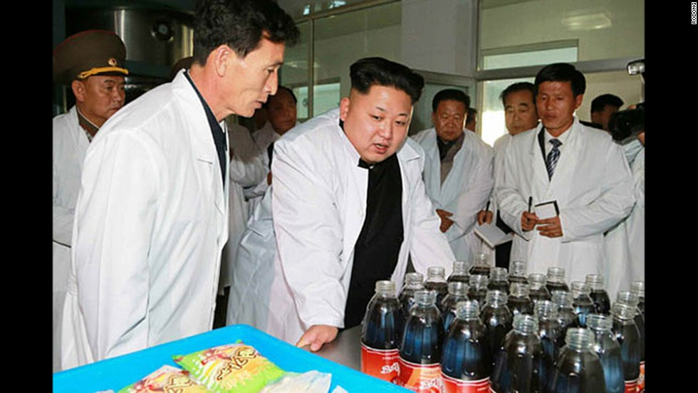 Kim Jong Un, center, leader of North Korea, inspects a model food factory in North Korea. The date of the visit is unknown.