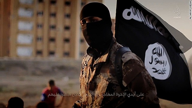 "An English-speaking ISIS fighter orchestrates the mass execution of a group of men in an ISIS recruitment video called ""Flames of War."""