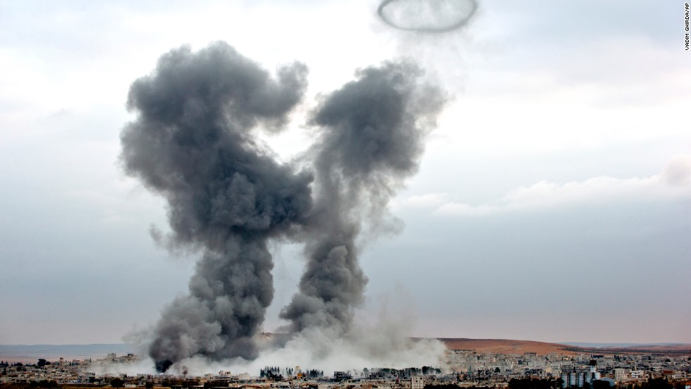 Smoke rises from the Syrian town of Kobani following airstrikes by the U.S. led coalition on the Turkey-Syria border on November 17.