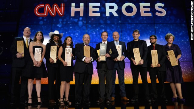 The 2014 CNN Heroes pose onstage during the 2014 CNN Heroes: An All Star Tribute at the American Museum of Natural History in New York City on Tuesday, November 18.