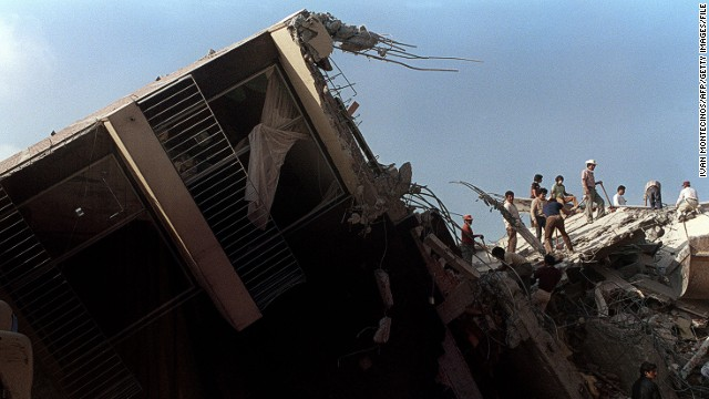 A photo taken 22 September 1985 shows rescue workers sifting through the rubble of a collapsed building in Mexico City, after an earthquake leveled parts of the city killing up to 30.000 people, 19 September 1985.