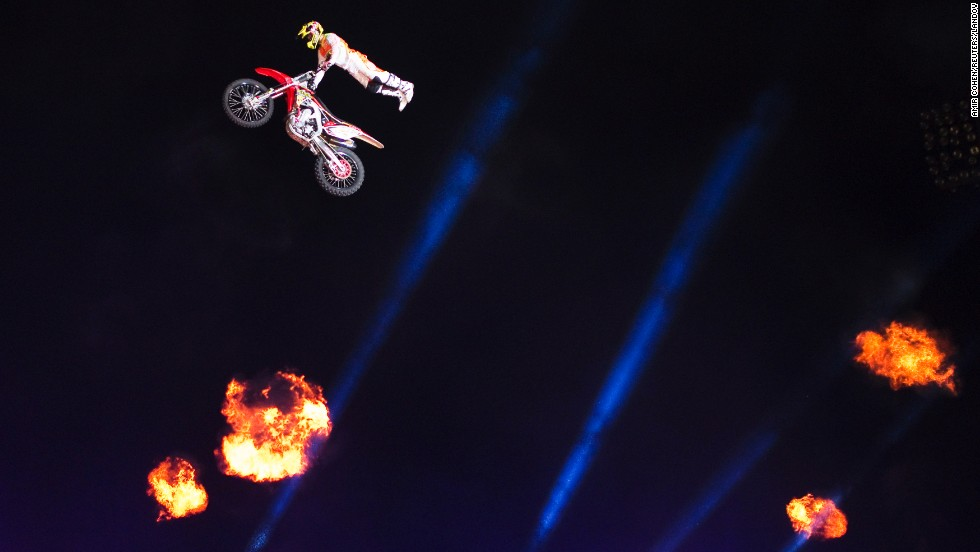 A motocross rider performs during a show in Ashkelon, Israel. Freestyle motocross involves high-flying stunts meant to impress judges.
